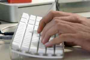 computer keyboard and hand technology business concepts